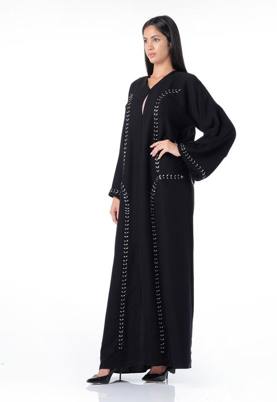 Abaya with an Arabic design, with golden buttons and embroidery on the edges