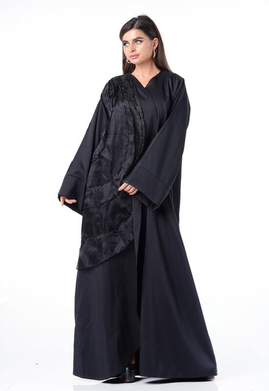 Abaya with a soft design, a solid black color