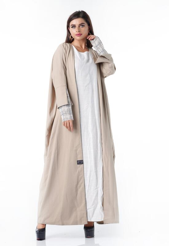 A practical beige abaya with wooded sleeves and two layers