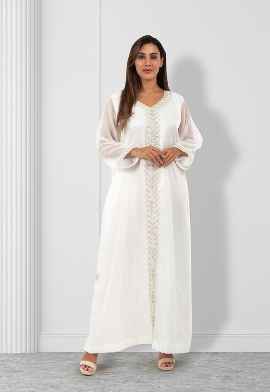 A white brothel with shiny embroidery with beads at the ends