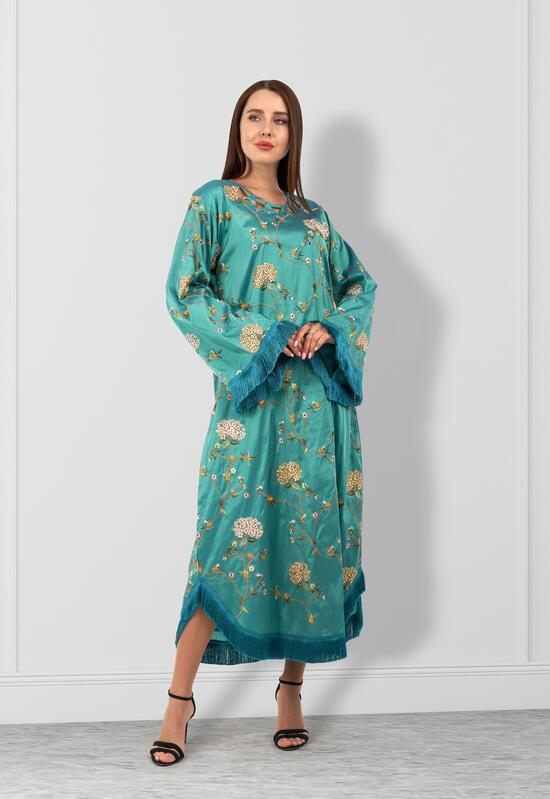 A bakhoor with an elegant design in tuquoise color embroidered in several colors
