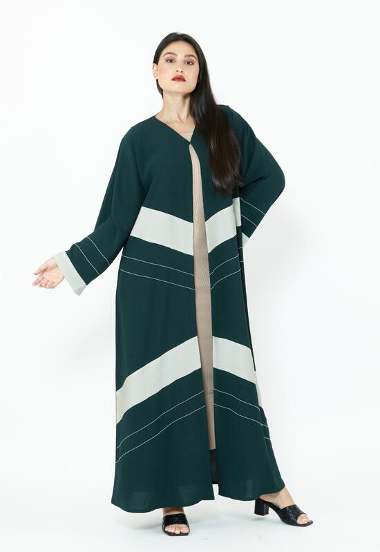 A soft green abaya with white overlap, giving it an elegant practicality