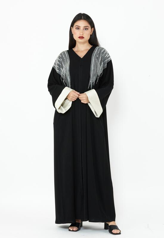 A black abaya with embroidery on the shoulders and a sheila