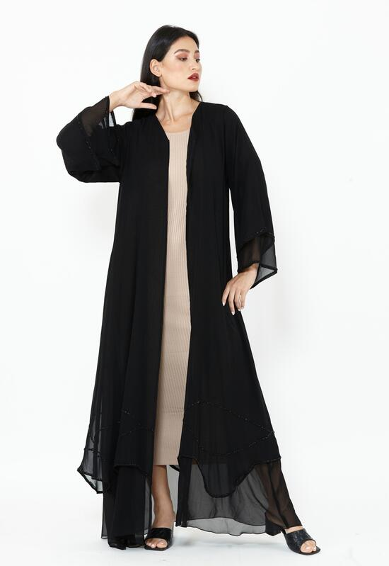 An elegant chiffon abaya, characterized by its jet black color, with flared sleeves